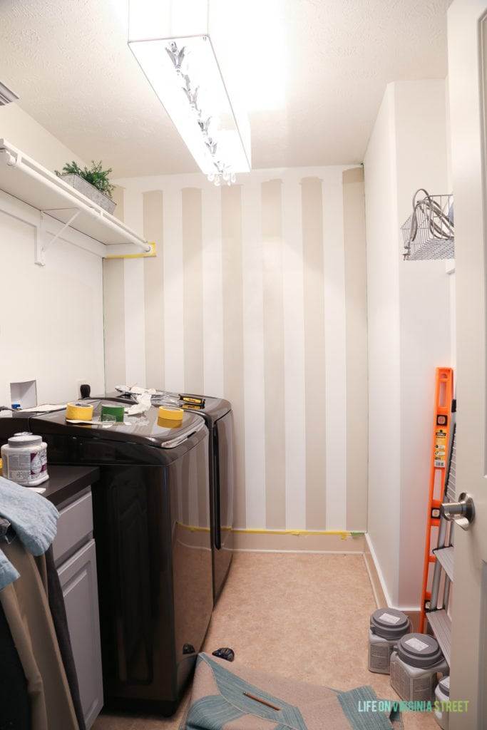 The beige striped buffalo wall in laundry all painted.