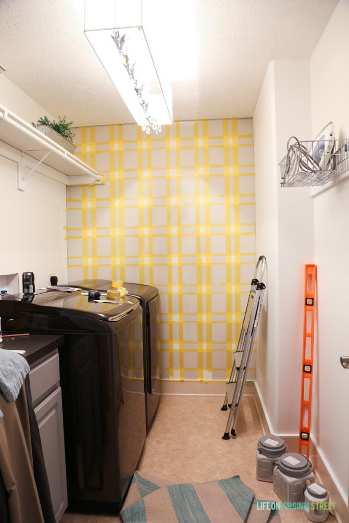 All the squares taped off on wall in laundry room.