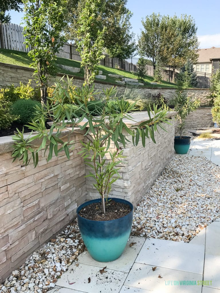Landscaped retaining wall on a slope.