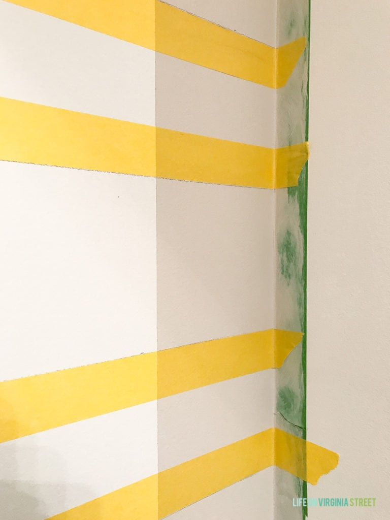 Next you will tape your horizontal lines. Again, it's important to use a level for this process to make sure your painters tape is perfectly level.