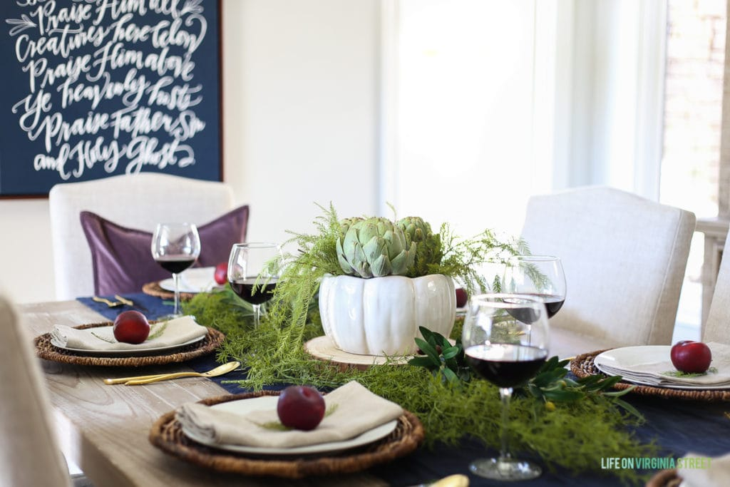 Thanksgiving Tablescape: How beautiful are the artichokes and the plums together? I love the contrasting colors on the table!