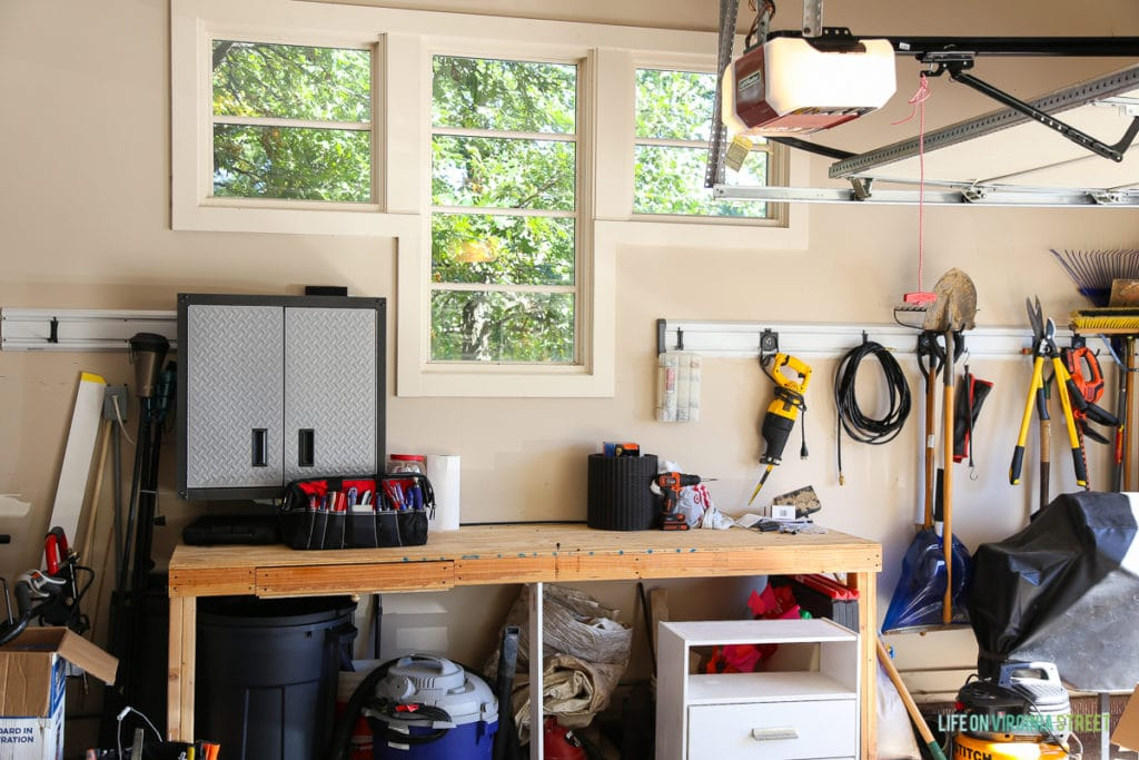 Inside of garage with workbench, and tools hanging on the wall.