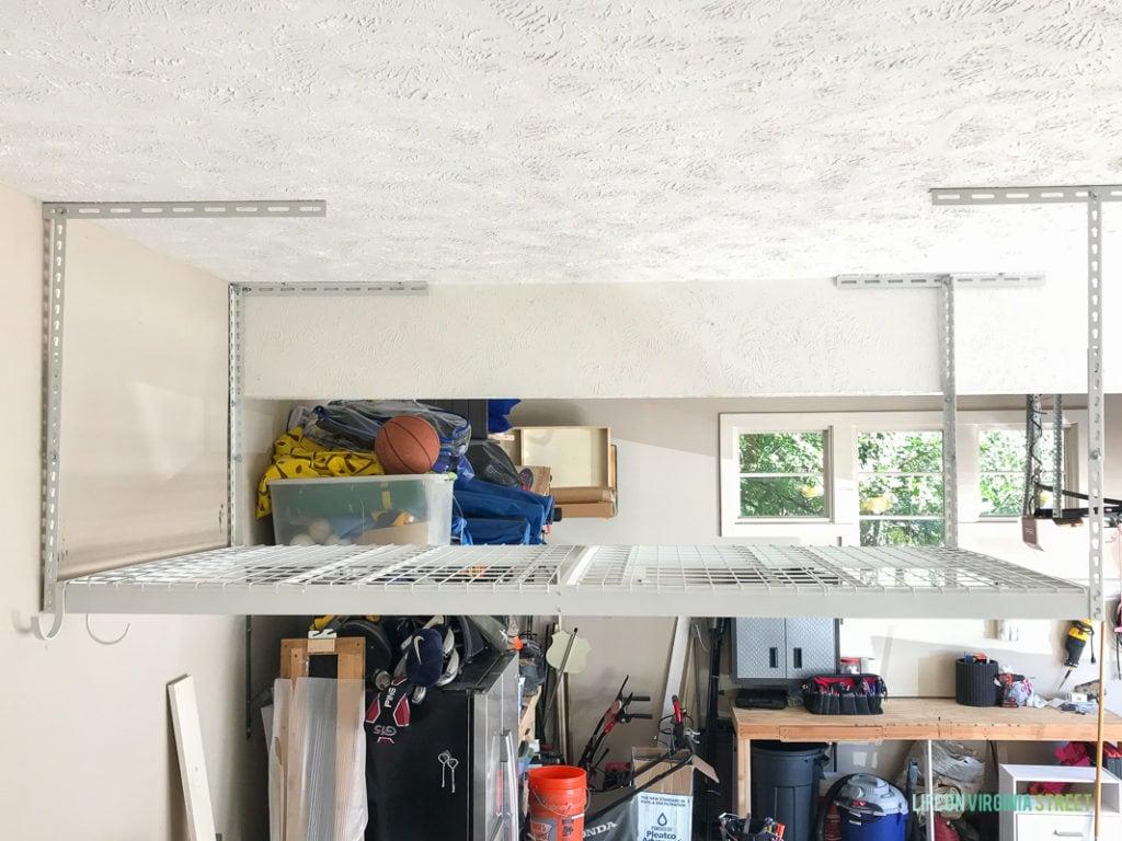 Garage door opened with items inside.