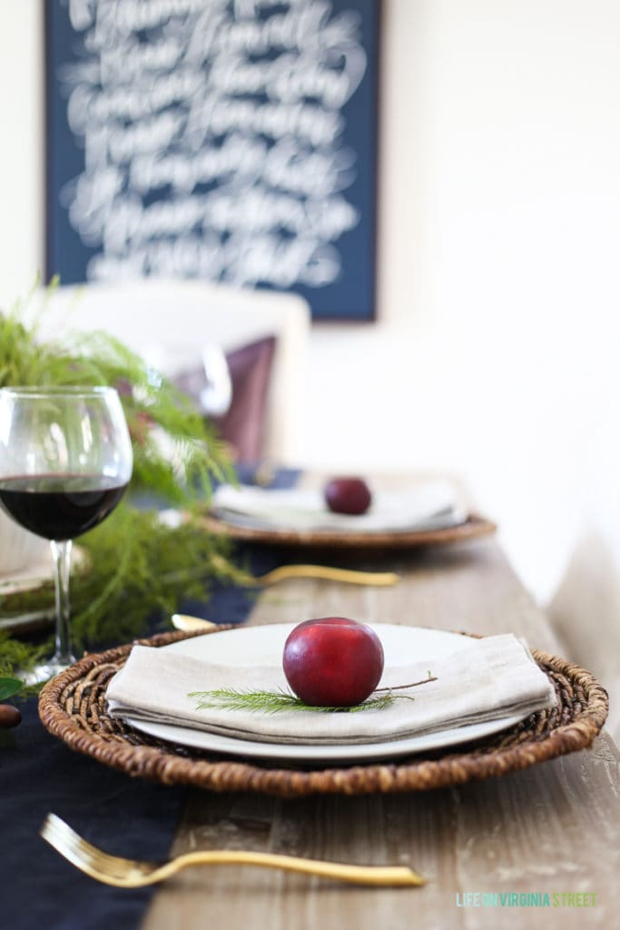 The plums and greenery create such a simple Thanksgiving Tablescape.