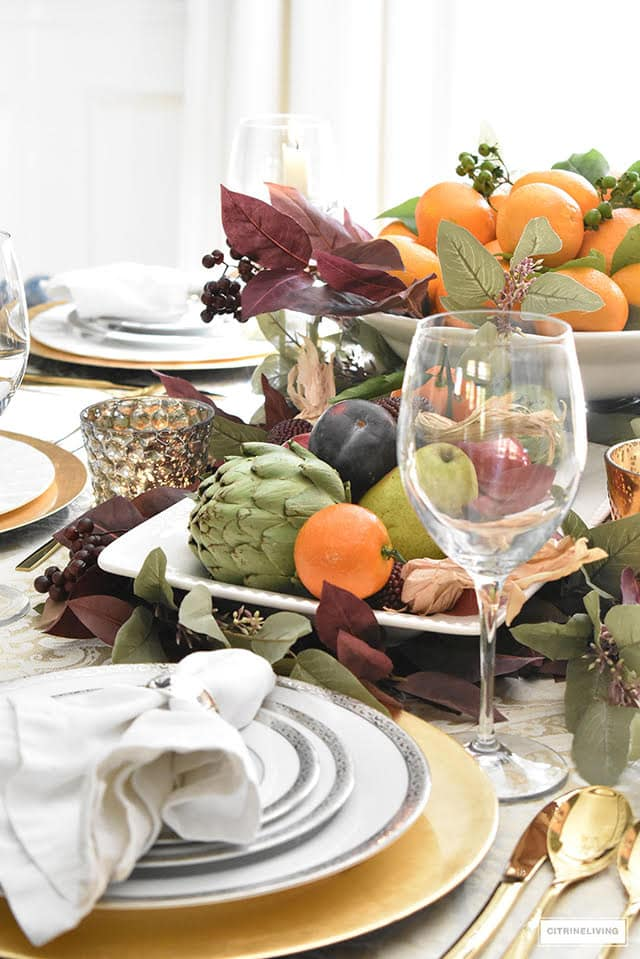 Citrine Living thanksgiving tablescape with citrus and tree fruits.