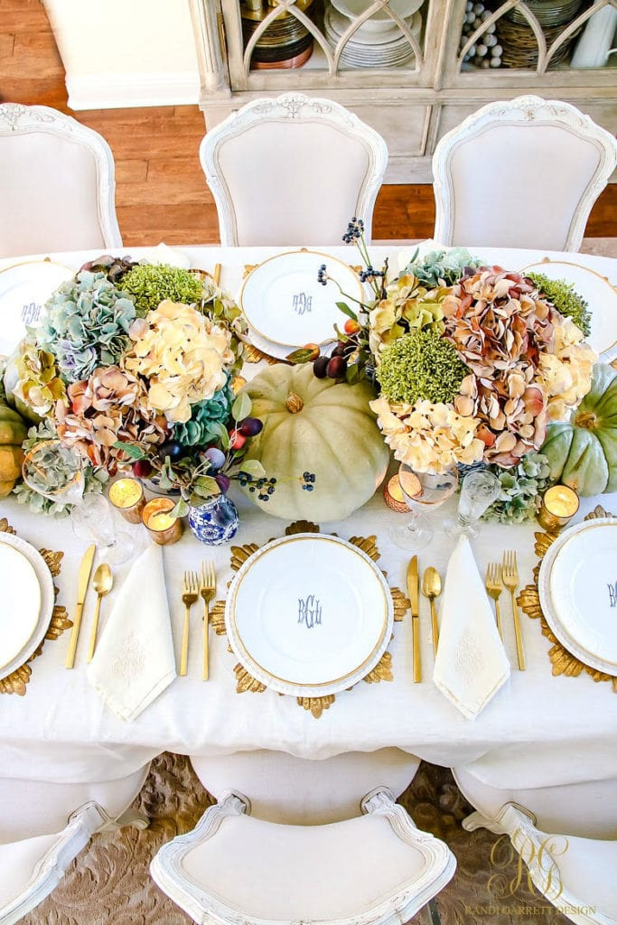 Randi Garrett Design Thanksgiving Tablescape with gold leaf, heirloom pumpkins and gorgeous florals.