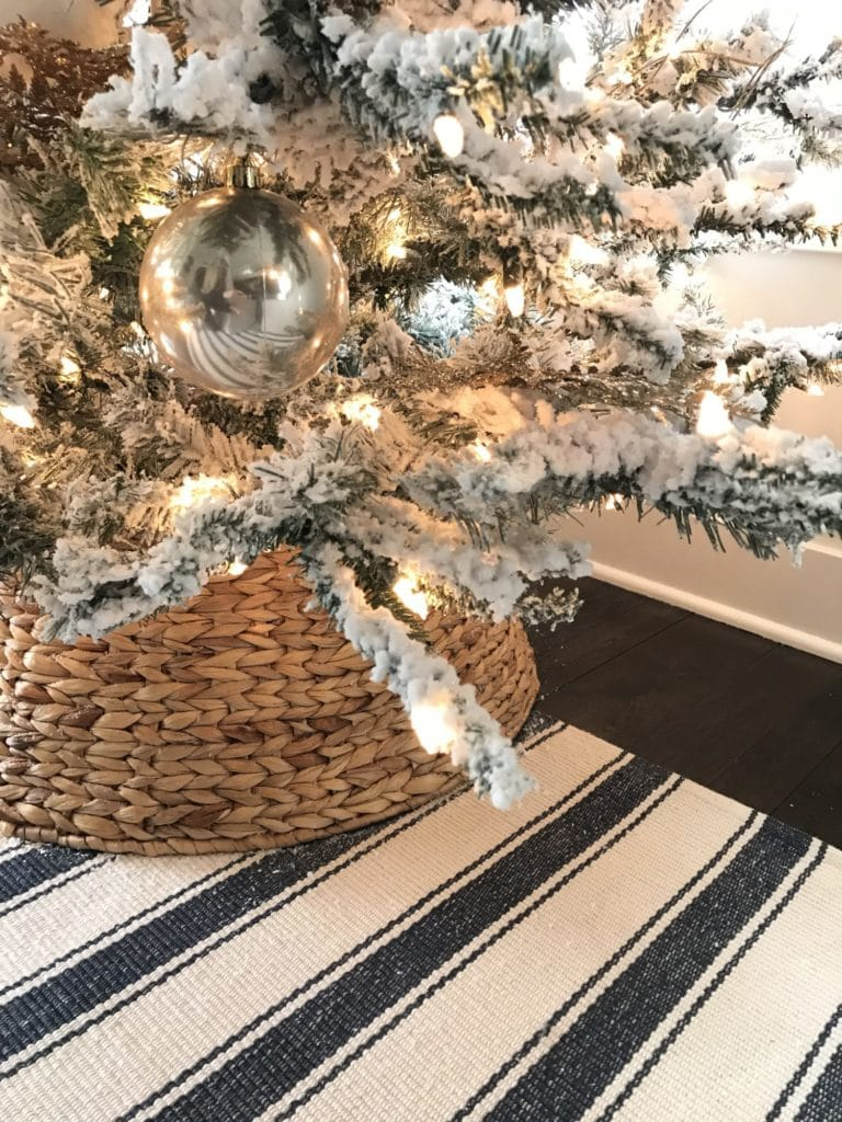 My new pre-lit Christmas tree with the woven tree skirt and striped rug - perfect beach vibe!