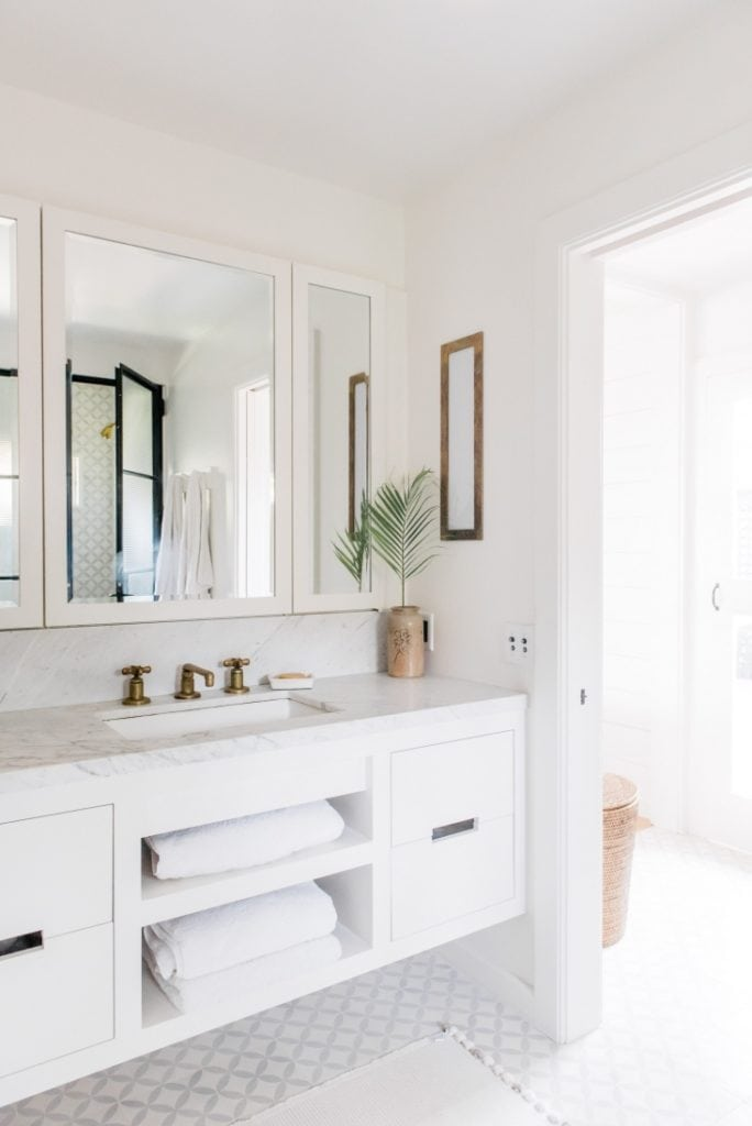 Adorable Hawaii beach cottage renovation! Look at this stunning white bathroom!