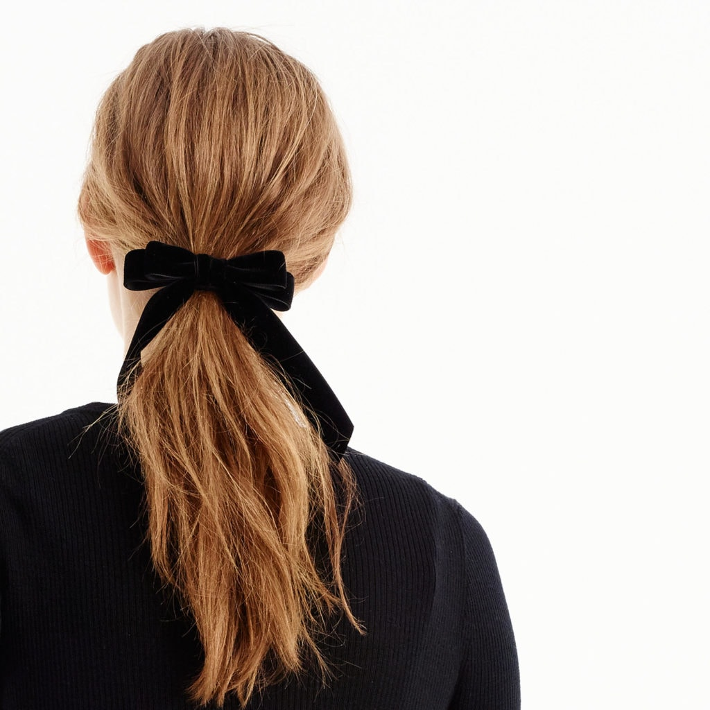 I love the classic look of this velvet hair tie. It dresses up any ponytail and comes in four colors including the black one shown here.