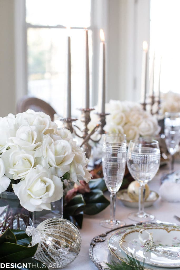 Christmas tablescape from Designthusiasm with white roses and tapers.