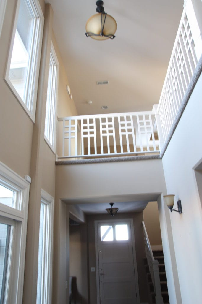 A look down the hallway and up to the second floor landing.