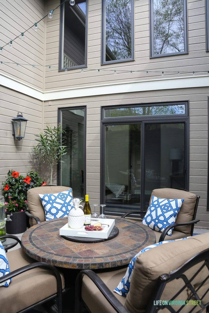 Outdoor courtyard with a firepit and blue and white accents.
