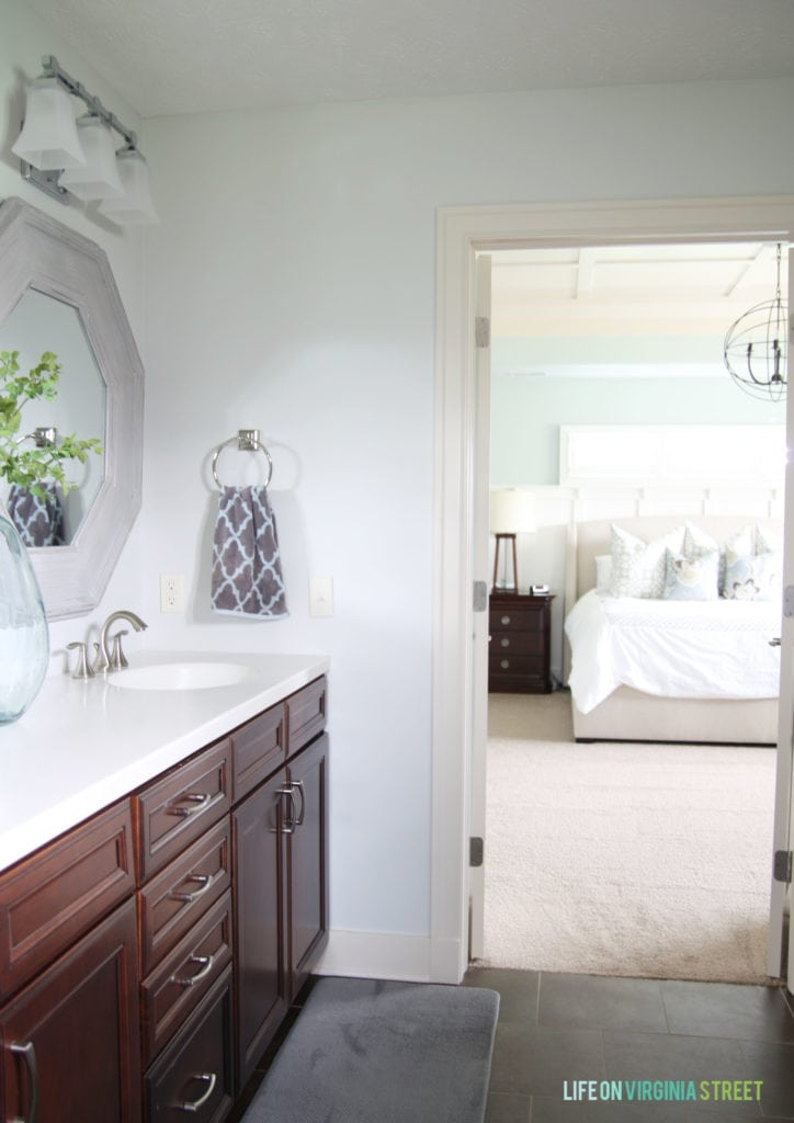 The master bathroom with it painted white and a bright mirror.