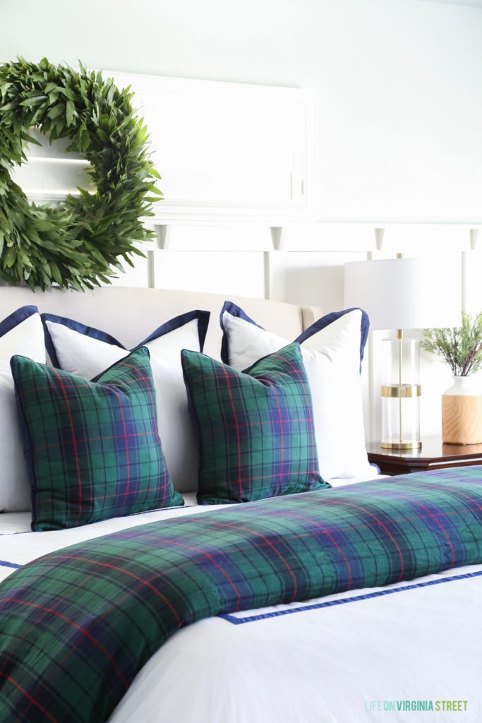Classic Christmas bedroom with Williams Sonoma Home plaid tartan bedding in navy blue and green.
