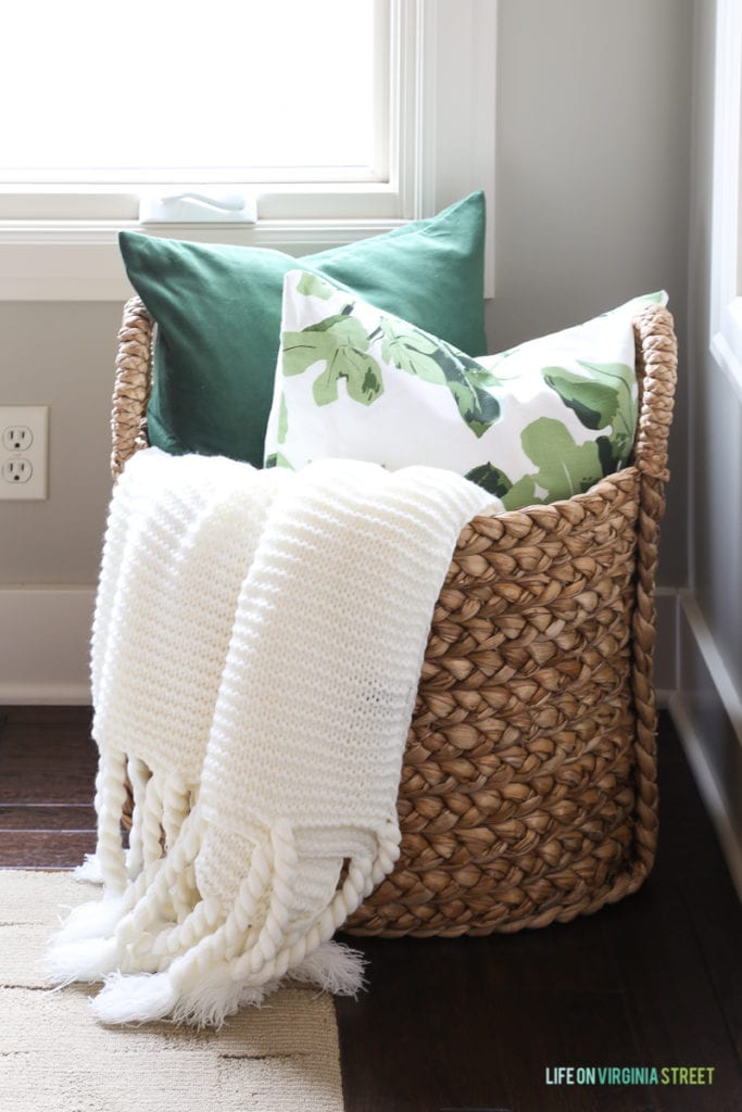 Beachcomber basket with green velvet and fig leaf pillow.