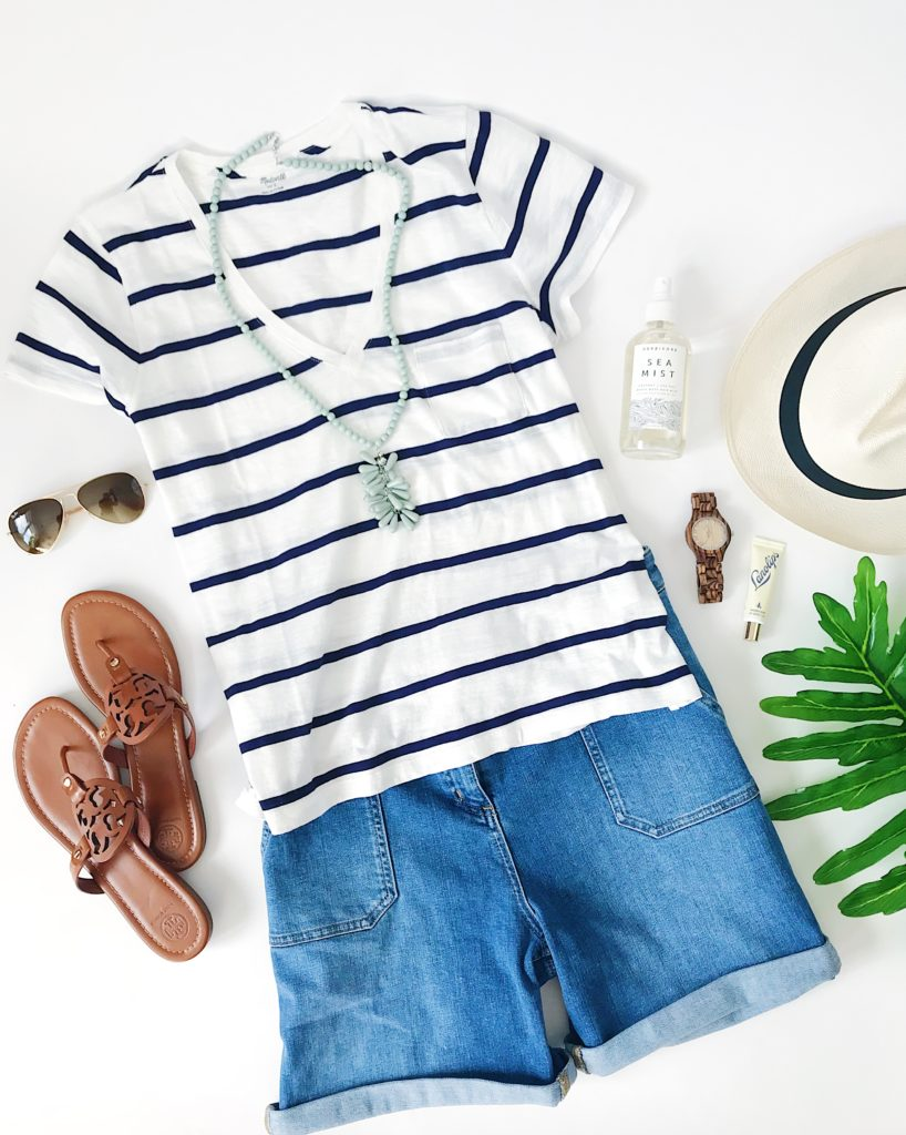 Blue and white striped v-neck tee shirt, denim shorts, wood watch, and leather sandals make for a cute spring or summer outfit with a beachy vibe!