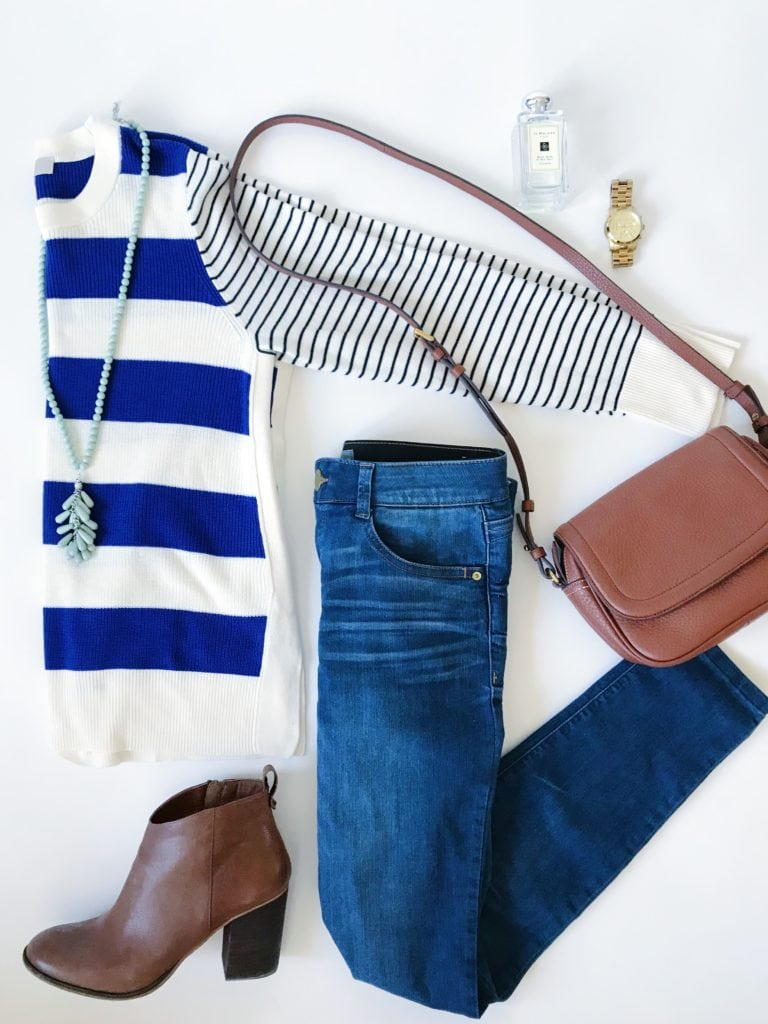 Mixed blue and white stripes sweater paired with skinny jeans, brown booties, a leather crossbody bag, tassel bead necklace and a gold watch.