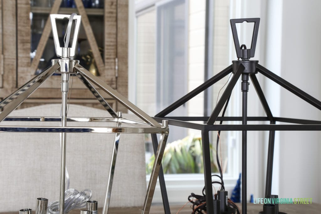 A chrome and also a black darlana light on the table.