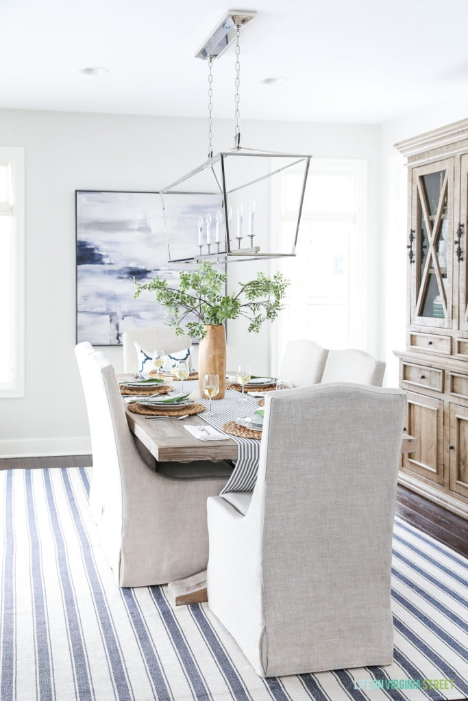 A navy blue and white coastal dining room with simple Easter decorating ideas and a pretty tablescape!