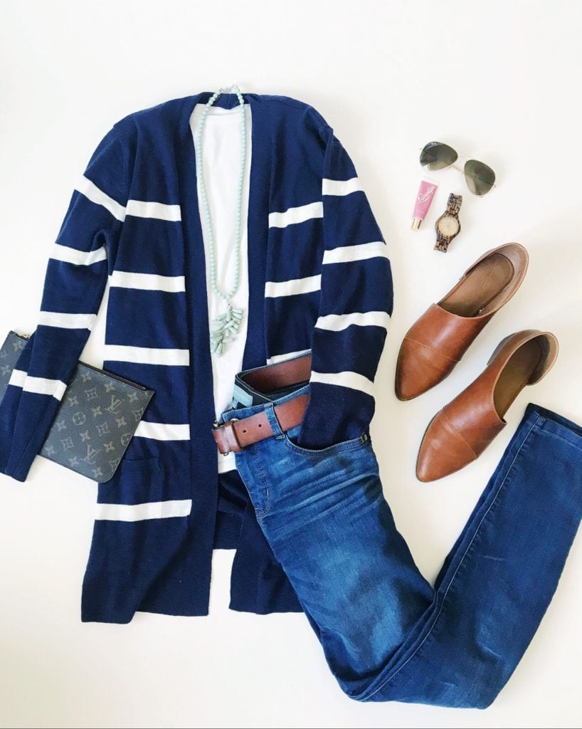 A long striped open cardigan, skinny denim jeans, booties, a Louis Vuitton clutch, aviator sunglasses and a wood watch. The perfect early spring outfit!