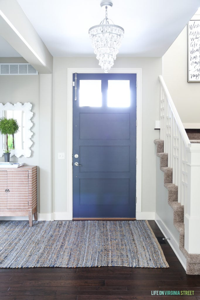 Navy blue and white spring entryway as part of a blue and white spring home tour. Front door color is Benjamin Moore Hale Navy.