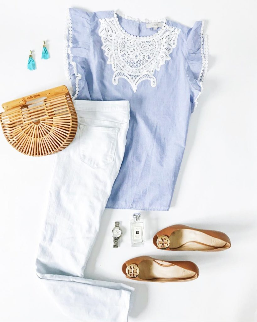 Blue top with crocheted lace flutter sleeve and bib, white denim jeans, Cult Gaia mini ark bag, Tory Burch wedges, Michele watch and tassel bead earrings. Such a cute spring outfit!