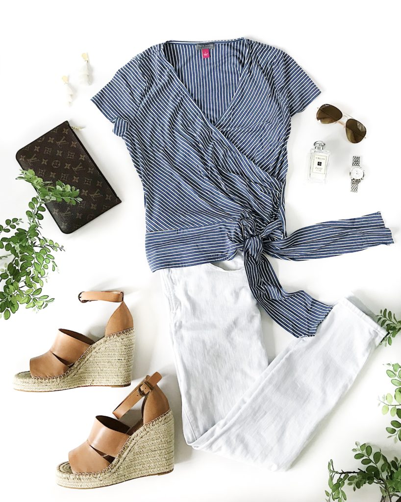Blue and white striped wrap top, white denim jeans, brown leather espadrille wedges, Louis Vuitton clutch, white tassel earrings, Ray-Ban sunglasses, Jo Malone cologne and a Michele watch. The perfect outfit for spring and summer!