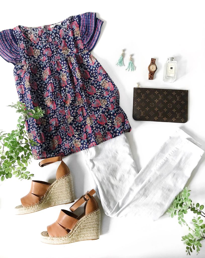 Boho style flowy top paired with white jeans, leather wedge espadrilles, bead earrings, Louis Vuitton clutch, and a wood watch.