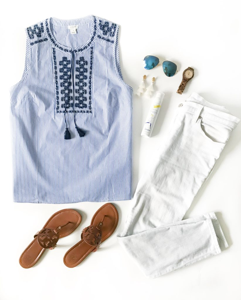 Striped and embroidered top, white jeans, brown leather Tory Burch Miller sandals, white tassel earrings and blue aviator sunglasses. Such a cute outfit idea for spring or summer!
