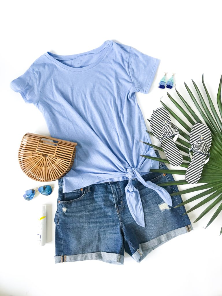 "Tie-front tee shirt with denim cut-off shorts and bamboo bag. I love that the top is slightly longer and cut-off jeans have a 5"" inseam! Such cute striped Tory Burch Miller sandals too!"