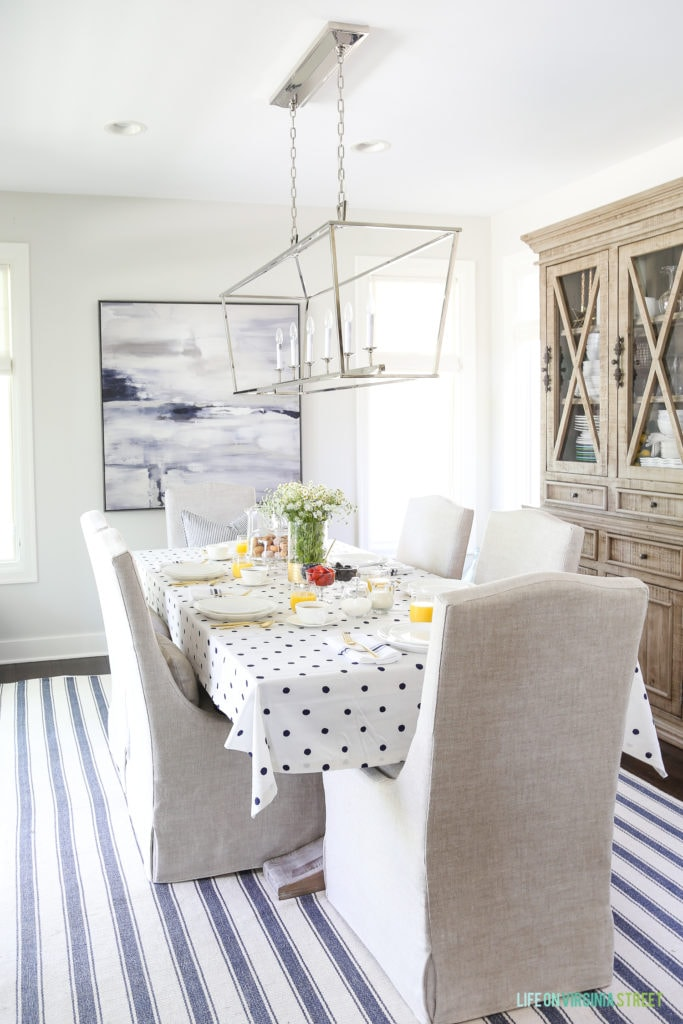 A coastal inspired brunch in a blue and white dining room. This post shares just how versatile the right white dishes can be, easily going from a casual brunch to a more formal version!