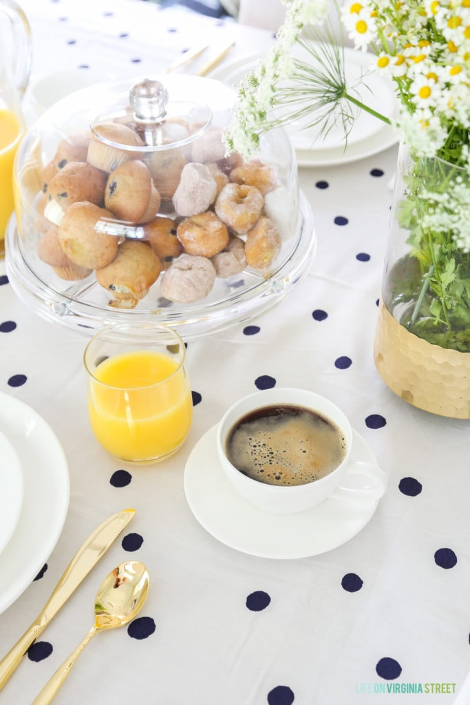 Donuts, and muffins in the covered clear cake stand.