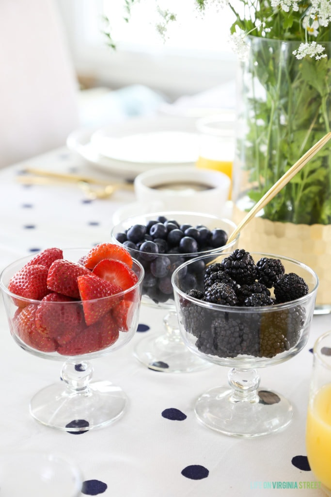 Up close of the strawberries, blackberries, and blueberries in clear bowls.