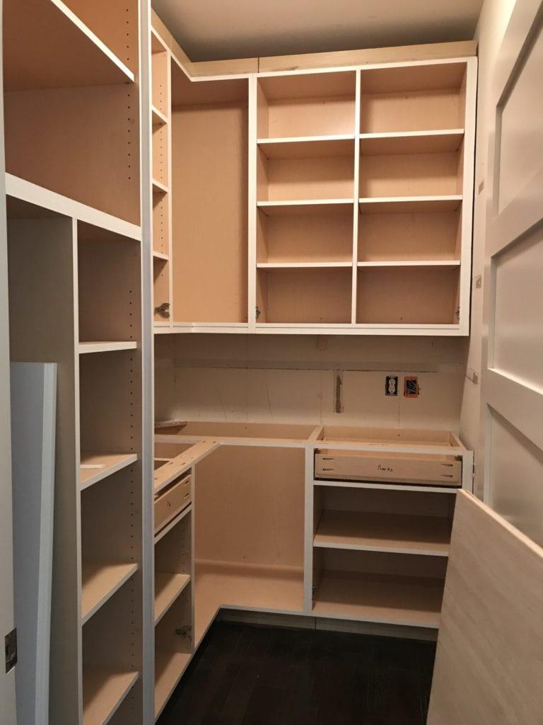 Installing the pantry shelves.