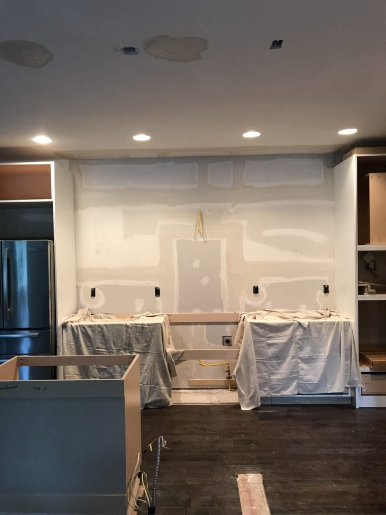A kitchen with the cabinets torn out.