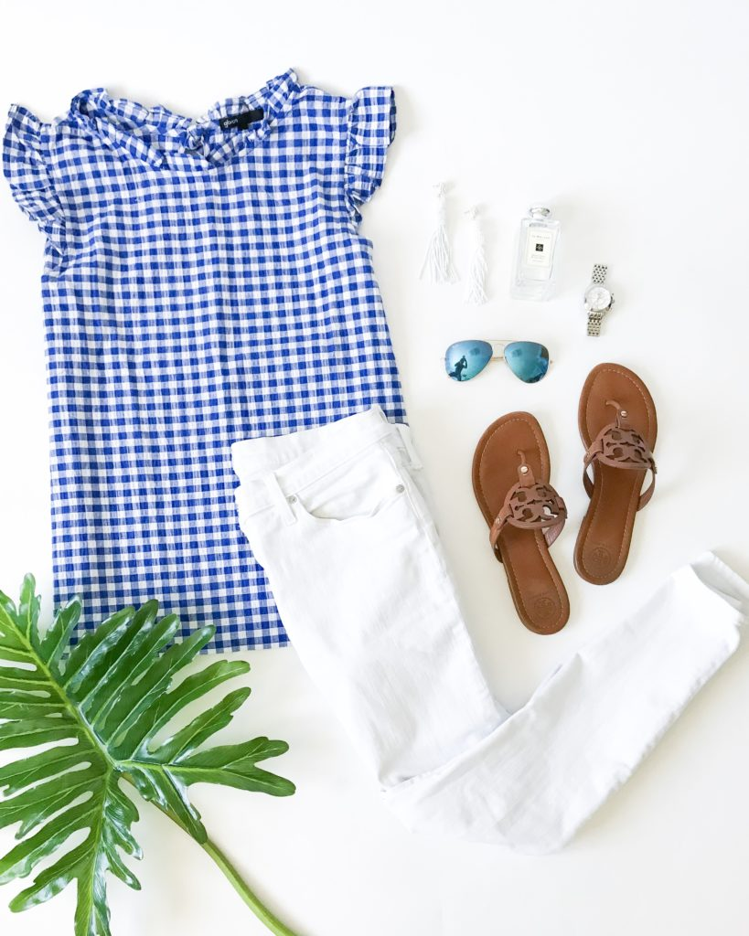 Blue and white gingham ruffle top with white denim and leather Tory Burch Sandals. Love the white bead earrings and the blue aviator glasses. Perfect outfit for spring or summer!