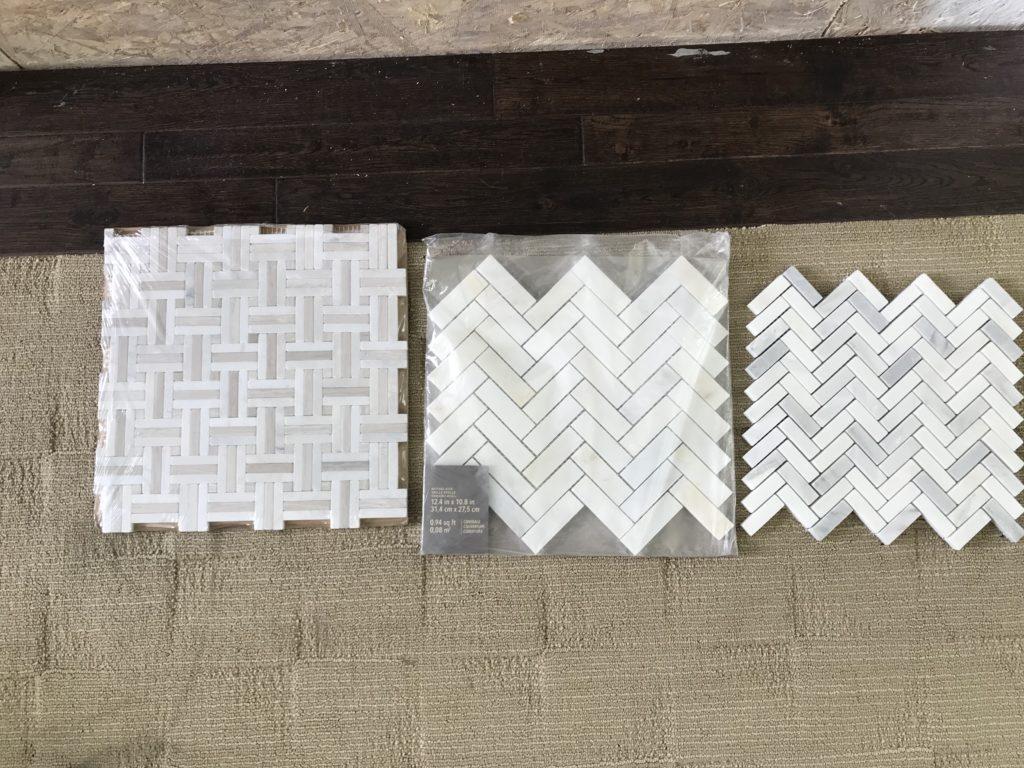 White tile samples on the floor.