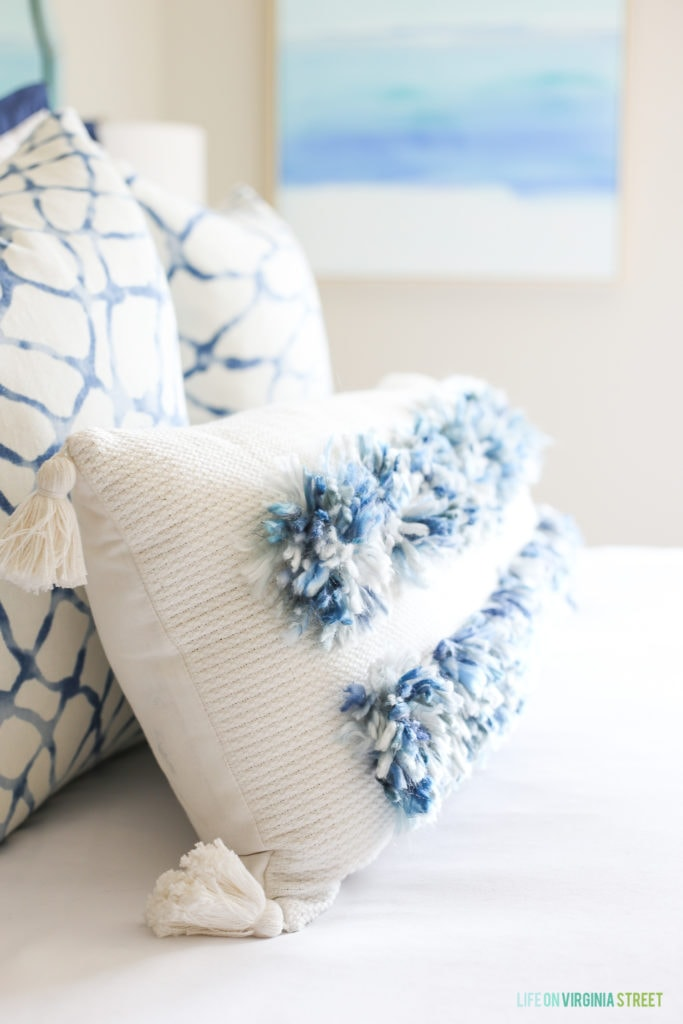 I love this lumbar tassel pillow with blue and white yarn poms!