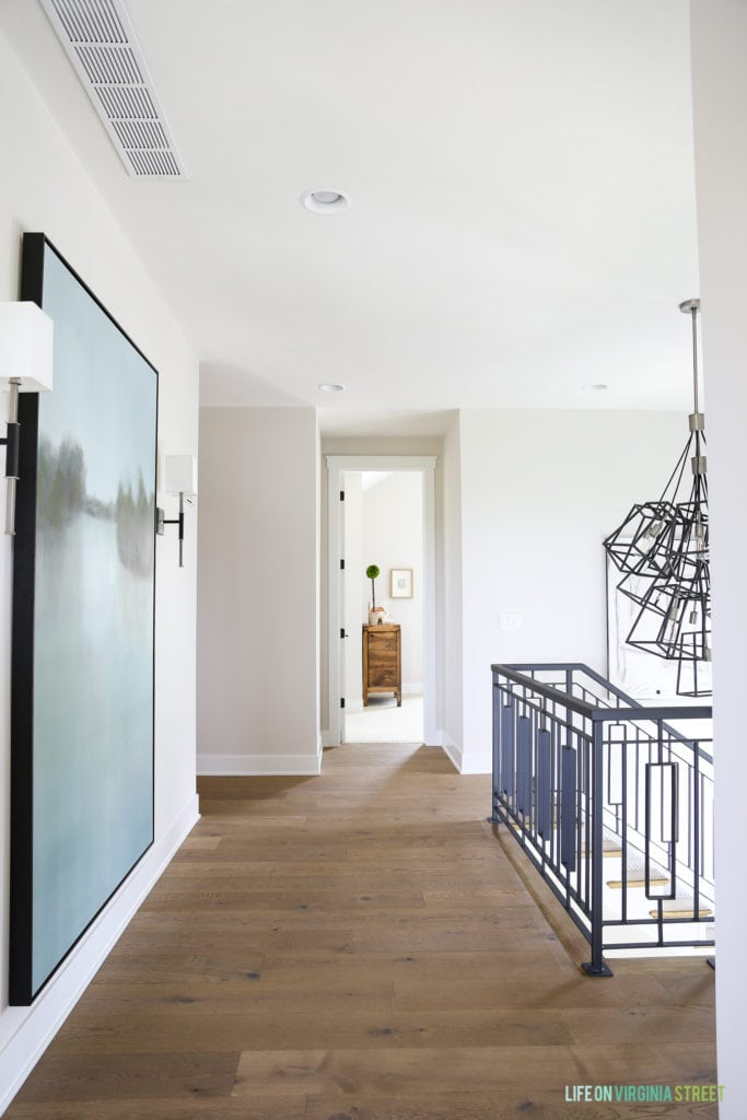 Light wooden floors down the hallway of the upper level of the house.