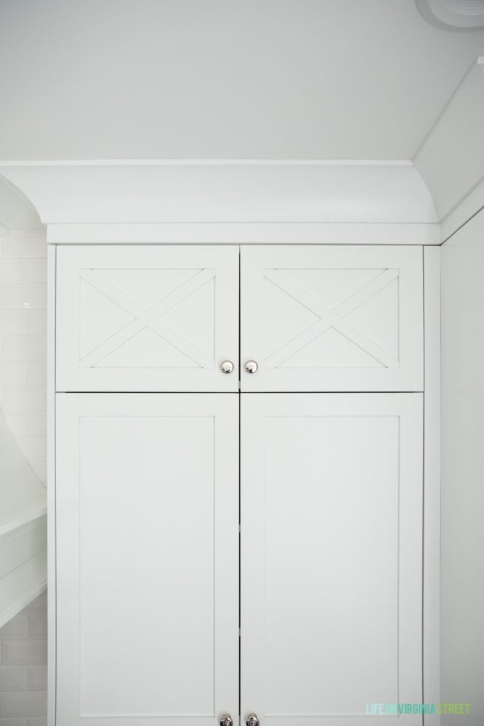 A white kitchen cabinet with silver pulls.