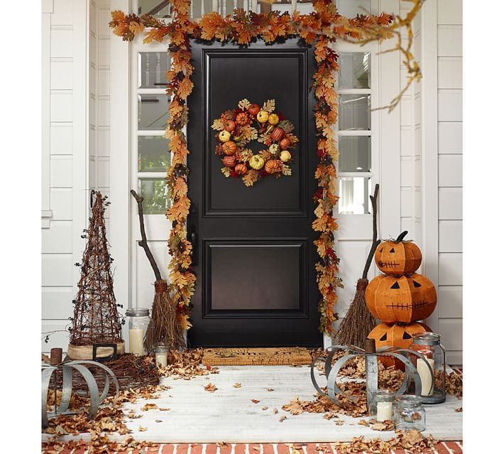 A fall porch with Halloween accents.