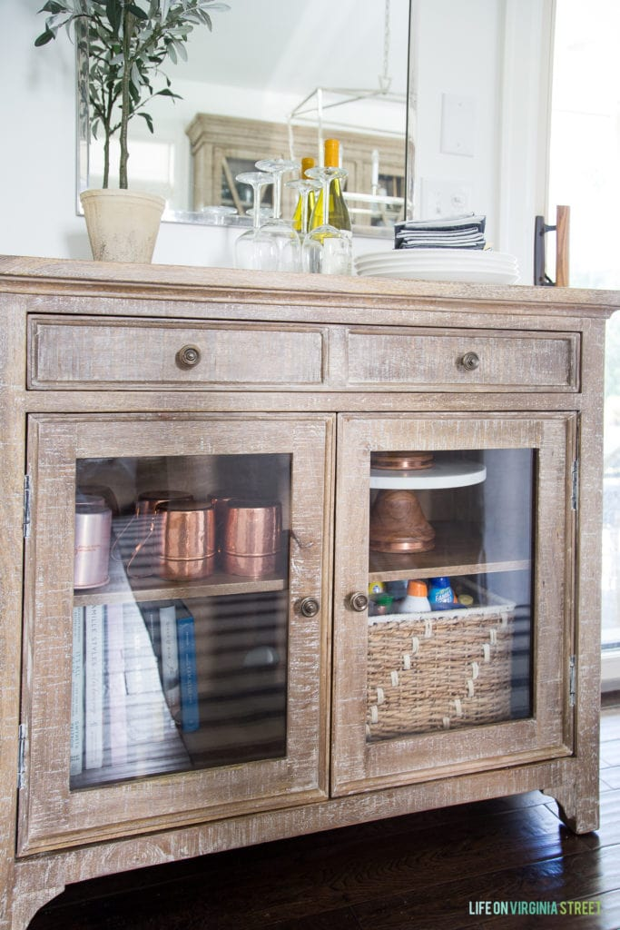 Wooden hutch with glass front doors and two drawers.