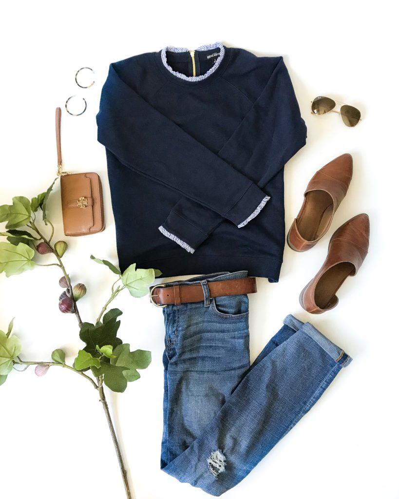 Cute fall outfit idea. Love this navy blue sweatshirt with blue and white striped ruffle collar and sleeves. Paired with boyfriend jeans, booties, and fall accessories!