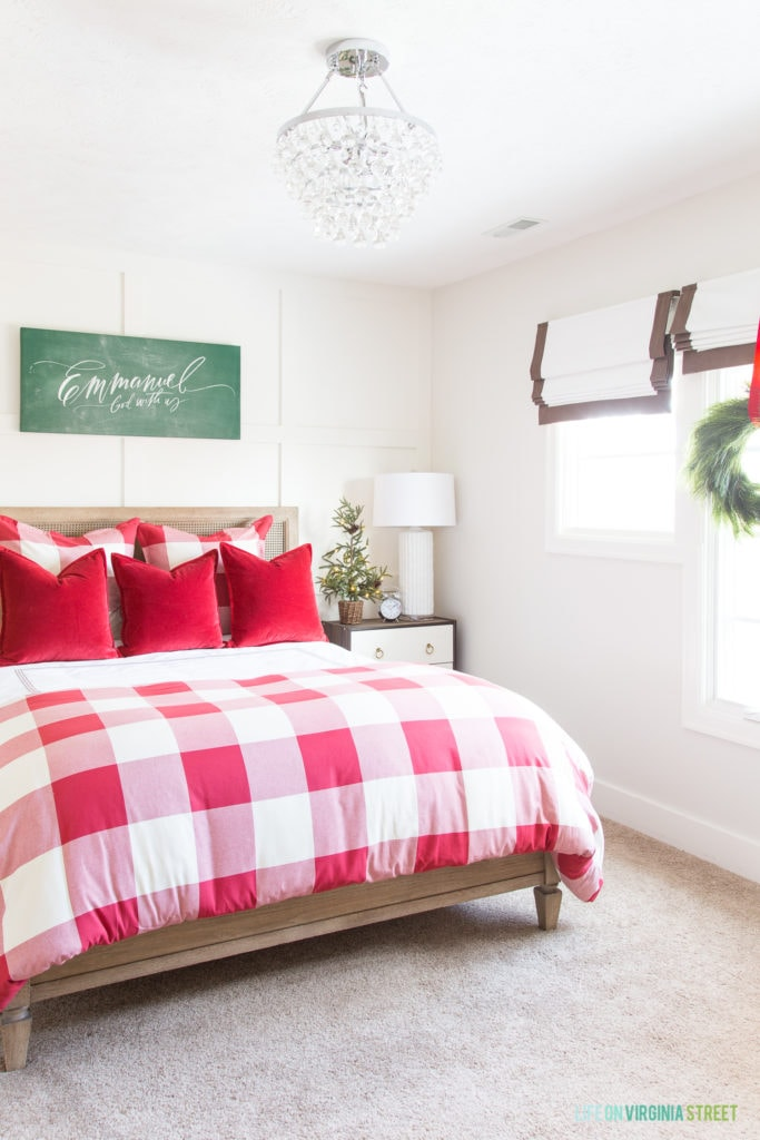 A cute red and white buffalo check bedroom that's perfect for Christmas! I love the Emmanuel chalkboard canvas over the bed and the wreath in the window.