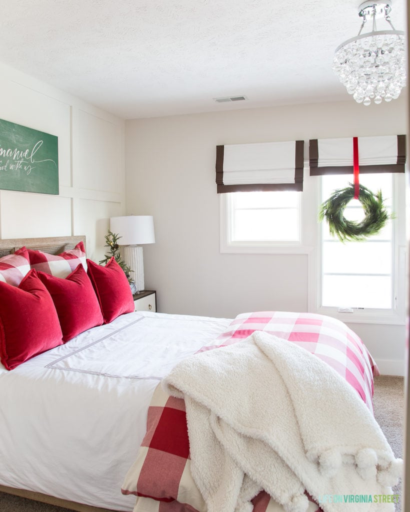 Red and white cozy winter guest bedroom. The buffalo check and red velvet add the perfect touch for Christmas and the holidays!