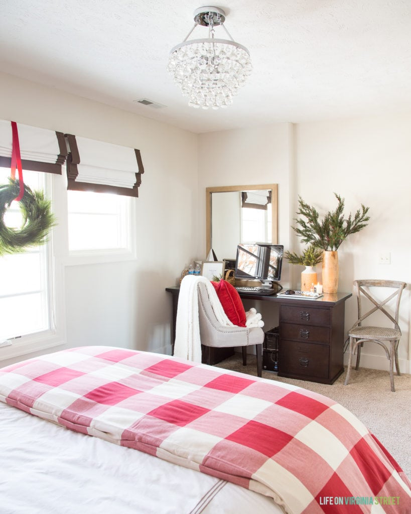 A desk area in a cute Christmas guest bedroom. I love the red and white buffalo check duvet cover.