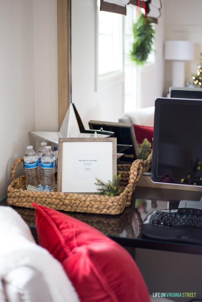 Great tips for preparing your guest bedroom for the holidays! Love this idea of leaving water bottles, protein bars, snacks and wi-fi access in the guest bedroom.