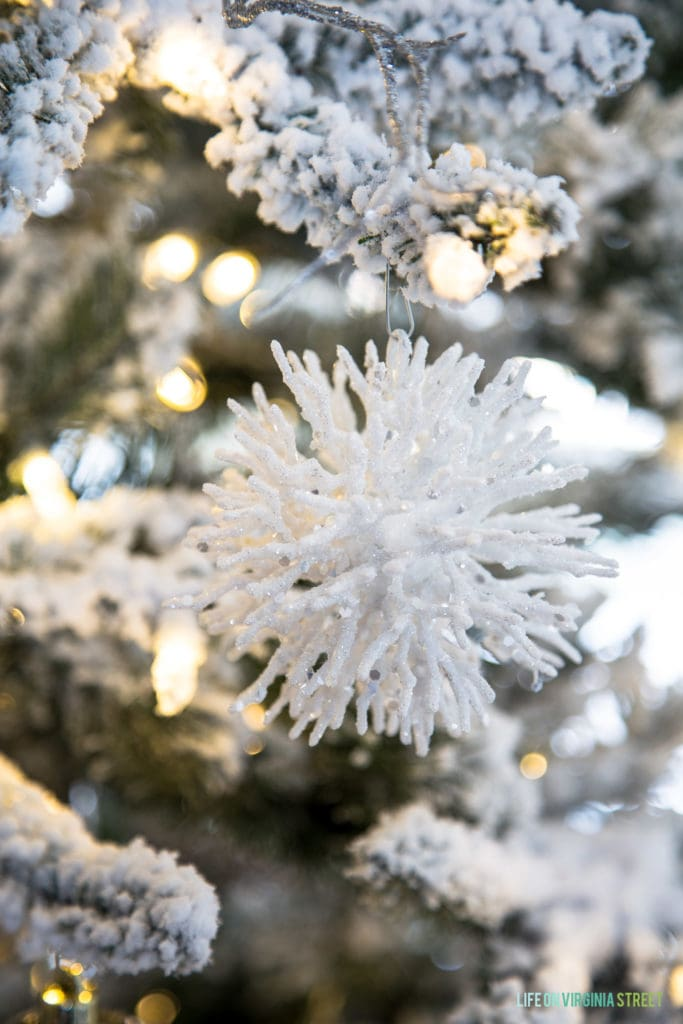 White spiky ornament on flocked tree.