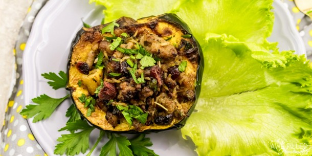 Air fryer roasted squash on a bed of lettuce leaves.
