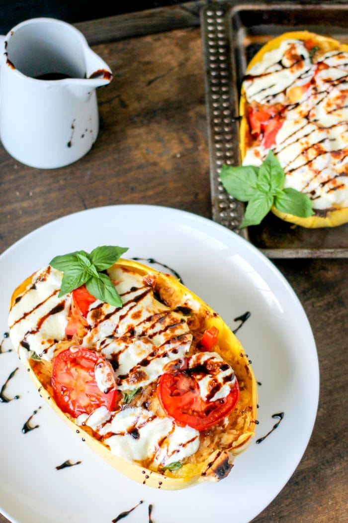 Caprese Stuffed Spaghetti Squash on a plate with balsamic drizzle.